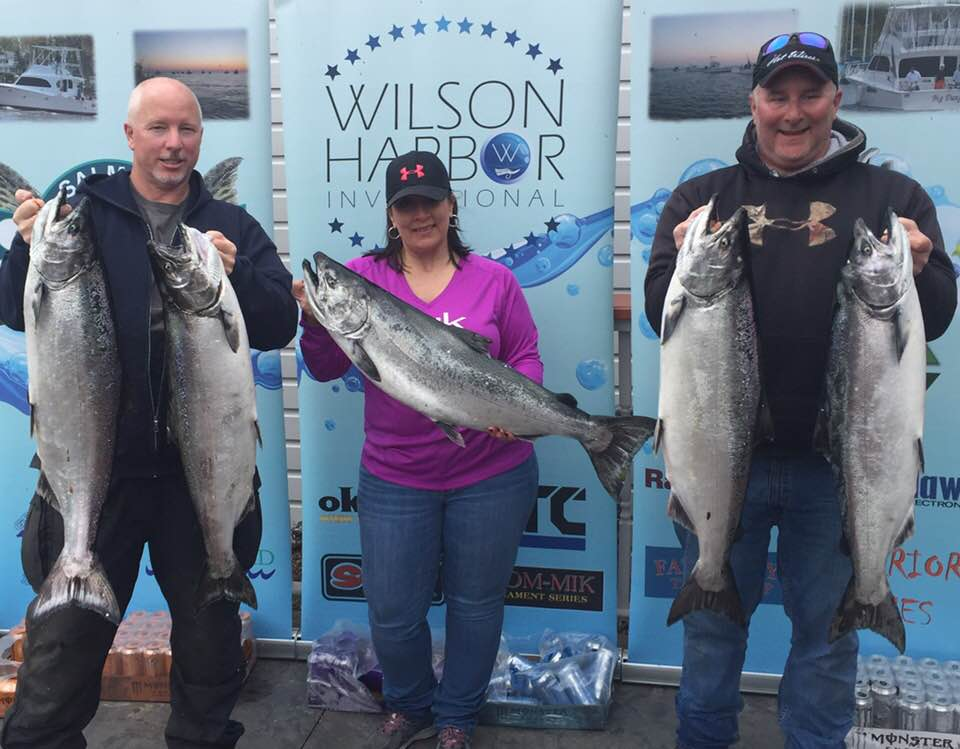 Tom Allen, Stephanie Brace (both of Oswego) and Lynn Thomson, Jr. of Camillus (left to right) who the Wilson Harbor Invitational Tournament with this catch on Saturday. They won a check for $20,000.