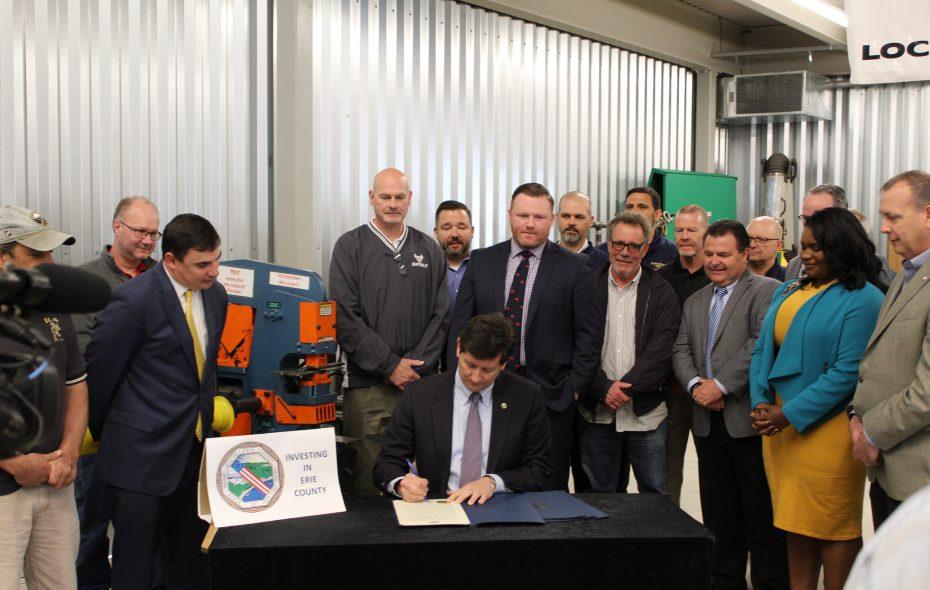 County Executive Mark Poloncarz signs an amendment to the county's apprenticeship law surrounded by Democratic county legislators and union leaders. (Provided by Erie County)