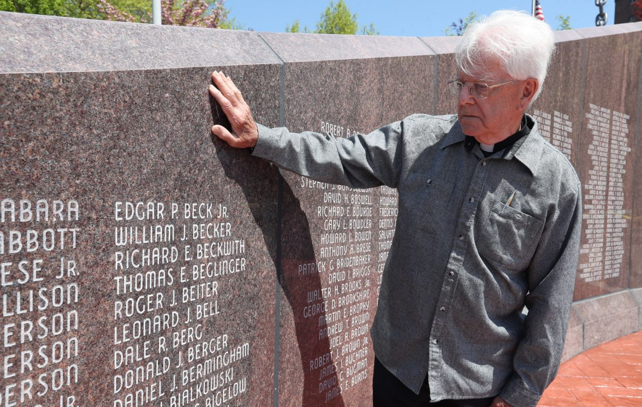 Rev. Robert Beiter stands near the name of his brother Roger on the Vietnam War Veterans Monument at the Buffalo & Erie County Naval & Military Park.  His younger brother, Roger J. Beiter, died in a plane crash on his way to Vietnam in 1965 at the age of 18.  (Sharon Cantillon/Buffalo News)