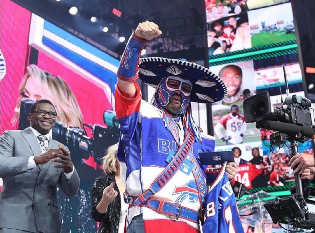 Pancho Billa, in the moment, on stage as the NFL Draft in April. (Image courtesy of Ezra Castro)
