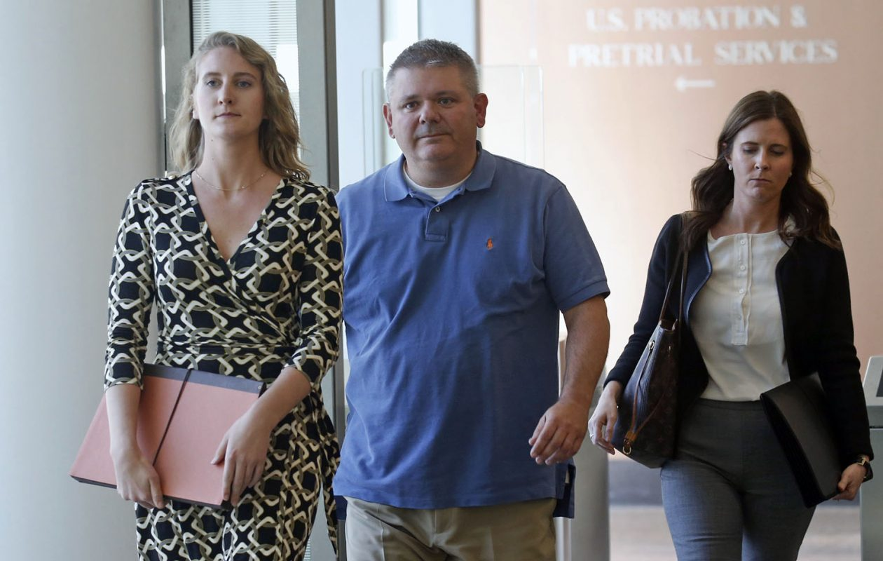 Kevin Schuler, center, gets escorted out of court with unidentified people after facing charges of  rigging and bribery at Buffalo federal court on Thursday, Sept. 22, 2016.  (Robert Kirkham/Buffalo News)