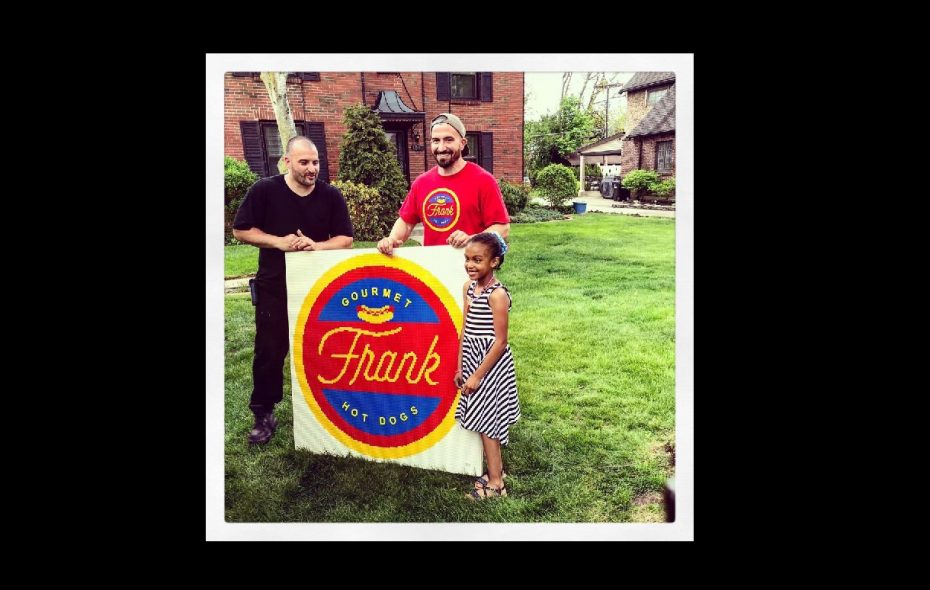 Mel, right, with a little help from her Uncle Mark, gave the Tripi brothers a Lego-built gift to remember before the Tripis opened their Kenmore Avenue restaurant. (Frank Gourmet Hot Dogs)