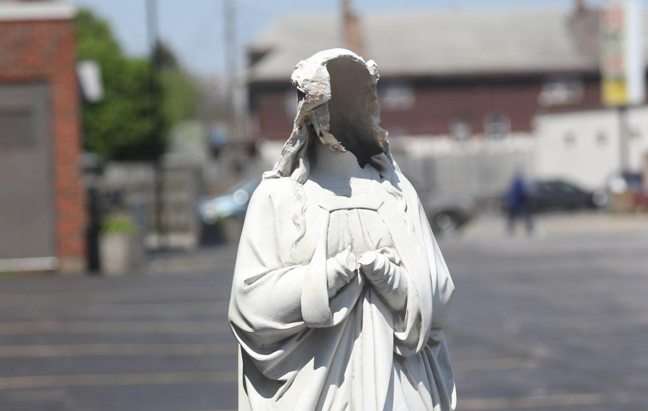 A statue of Mary outside St. John Kanty Catholic Church was damaged May 15. (John Hickey/Buffalo News)