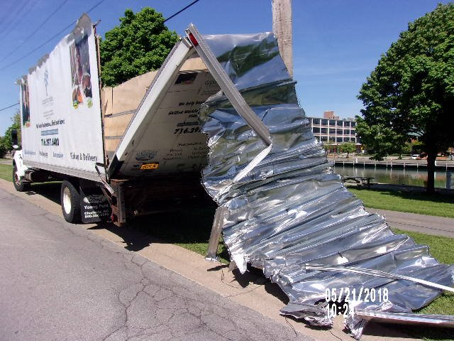 A box truck driver was issued three traffic citations Monday after he drove into a railroad bridge. (City of Tonawanda Police)
