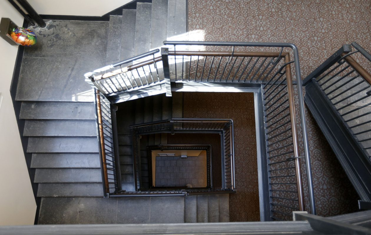 The stairway winds up to the 4th floor of Cathedral Commons on Pearl St.  (Mark Mulville/News file photo)