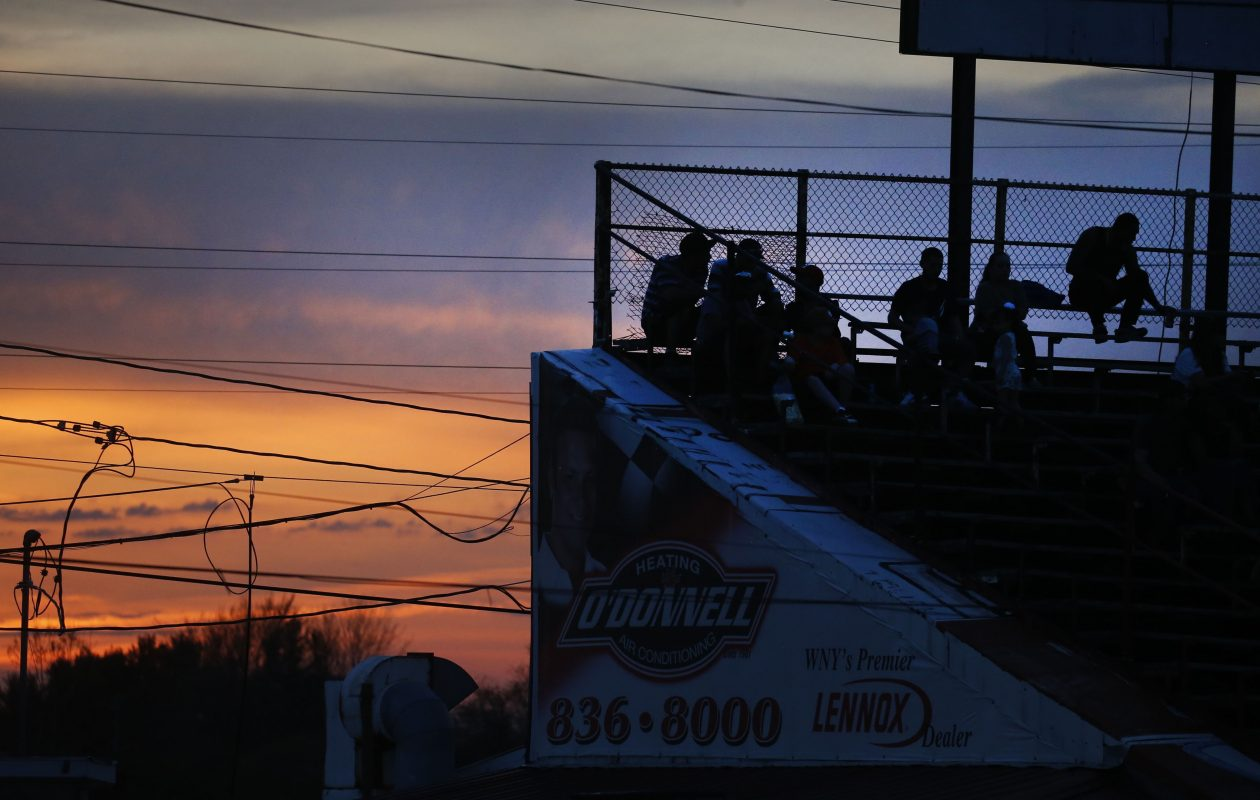 Fans watch the action from the stands at Lancaster National Speedway on Gunnville Road in Lancaster on Wednesday, May 9, 2018.  (Robert Kirkham/Buffalo News)