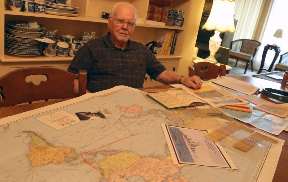 WWII Navy veteran Robert F. Wiedemer with a map of where he sailed while a crew member of the USS Anthony, a destroyer credited with shooting down 23 enemy planes in the Pacific. (John Hickey/Buffalo News)