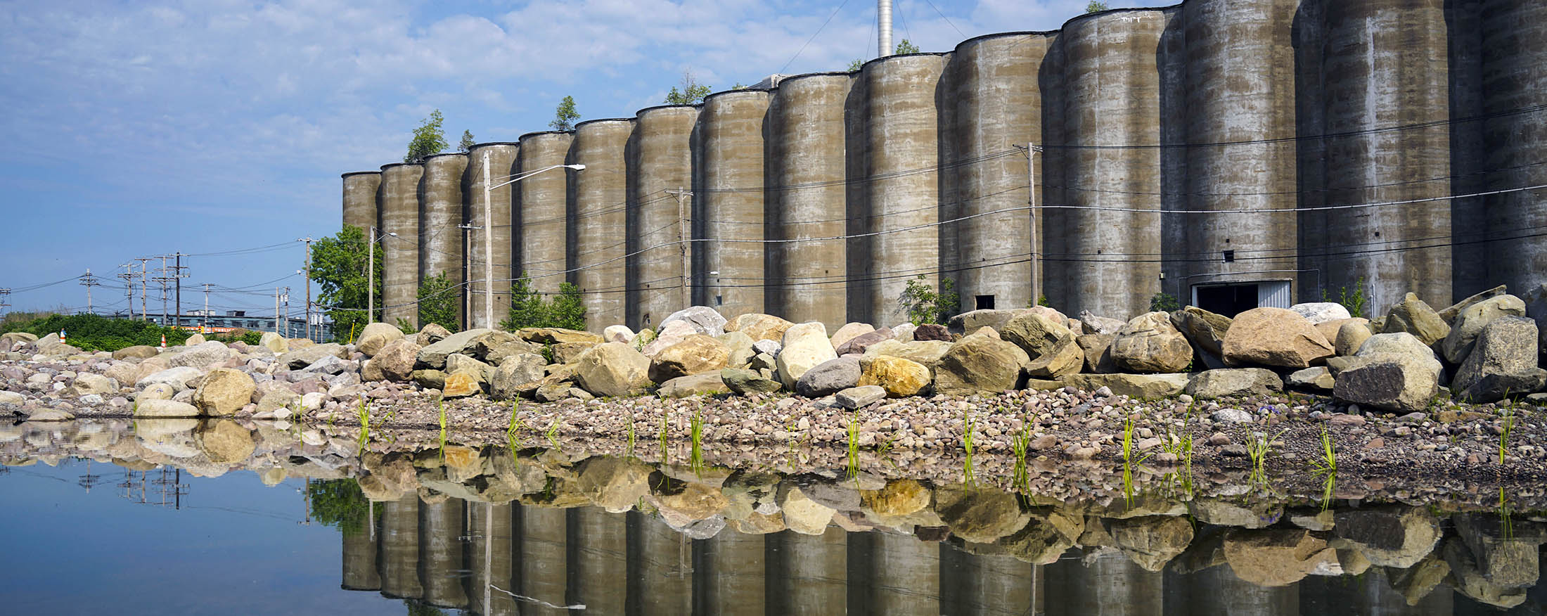 The Gelmac elevator, reflected in a rainwater retention pond at Silo City. (Derek Gee/Buffalo News)