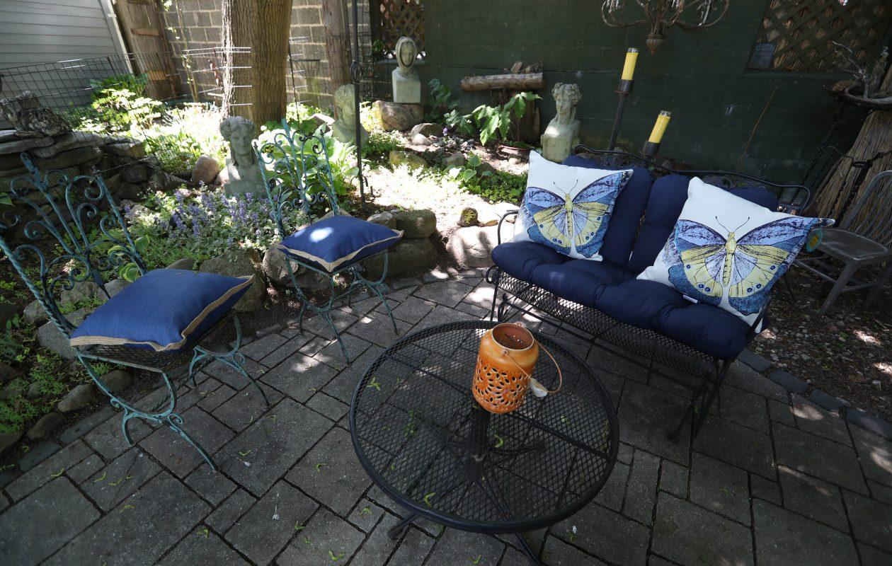 The back patio is a favorite destination on summer evenings.  (Sharon Cantillon/Buffalo News)