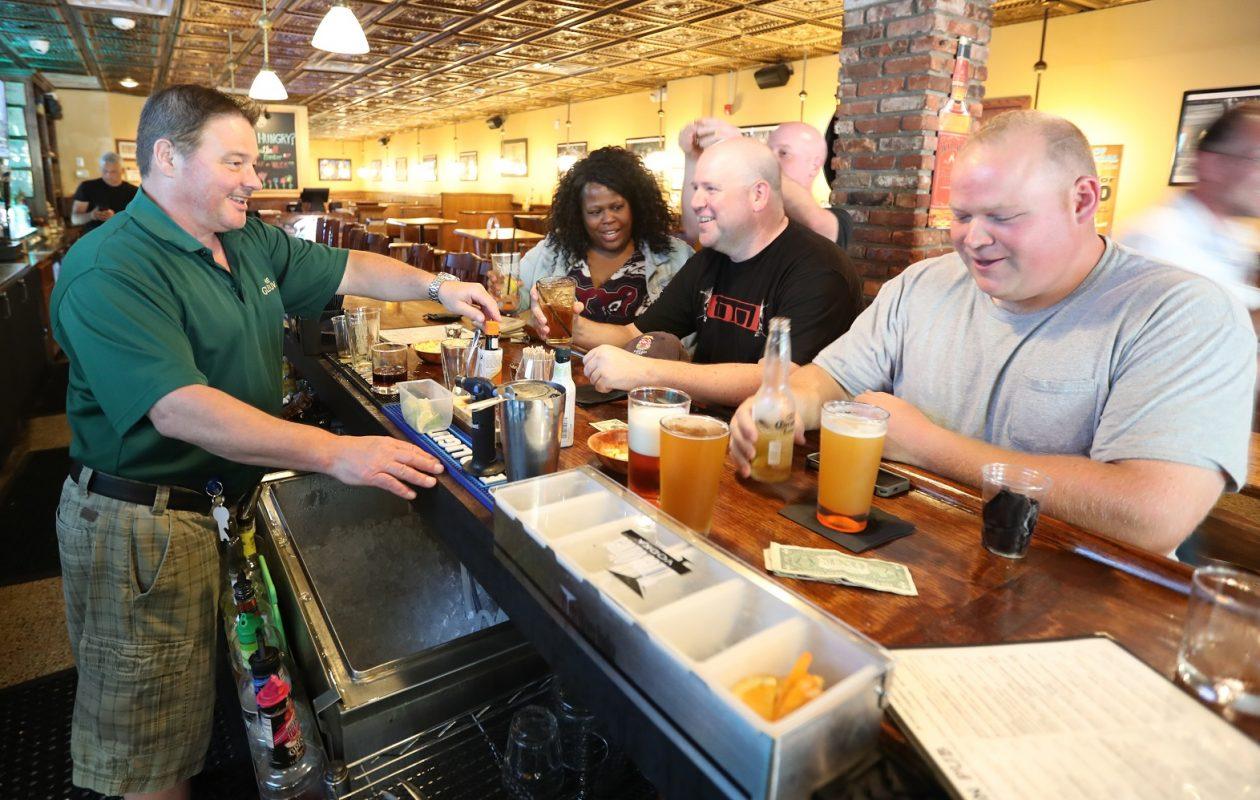 Billy Johnson makes customers smile with his jokes at Union Pub. (James P. McCoy/Buffalo News)