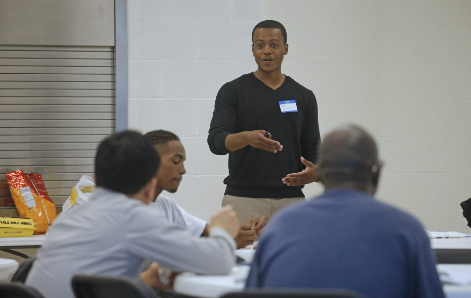 "Coordinator Antoine Johnson leads a discussion on ""teachable moments"" the men experienced over the past week during a Nurturing Fathers Program session in the Delavan-Grider Community Center. (Robert Kirkham/Buffalo News)"