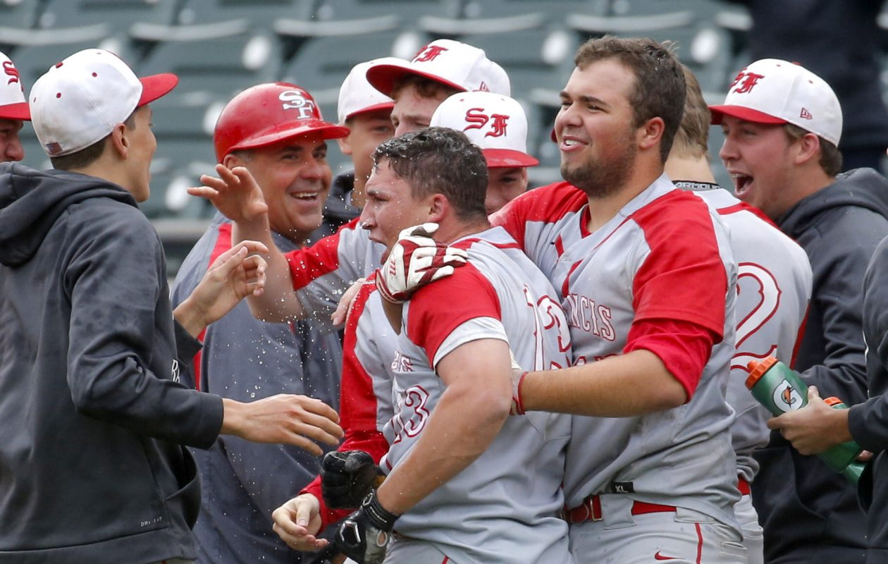 Brett Hilton gets mobbed by his teammates after driving in the championship-clinching run Tuesday at Coca-Cola Field. (Robert Kirkham/Buffalo News)