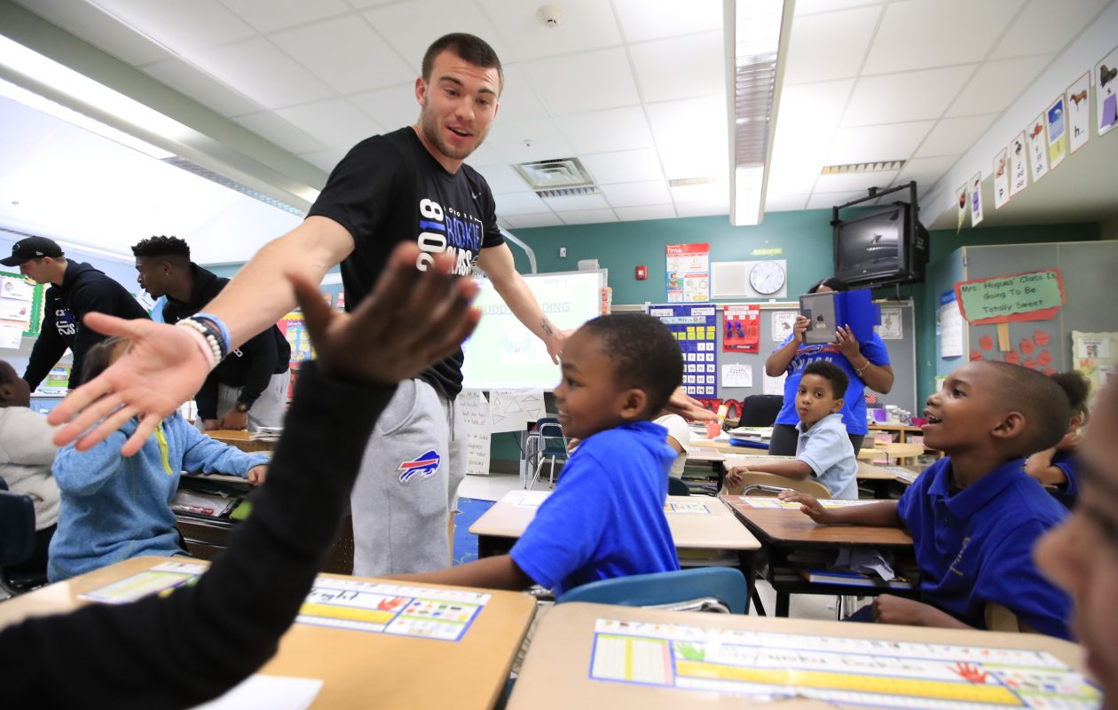 Buffalo Bills rookie Austin Proehl greets students at the Stanley Makowski Early Childhood Center on Wednesday June 6, 2018. (Harry Scull Jr./ Buffalo News)