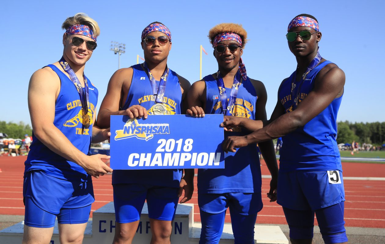 Cleveland Hill runners Chris Diem, Aaron Wahler, D'Mario Grant, and Javon Thomas pose with the first place medal after winning the Division 2, Boys 4x100 relay at the New York State Track and Field championships. (Harry Scull Jr./ Buffalo News)