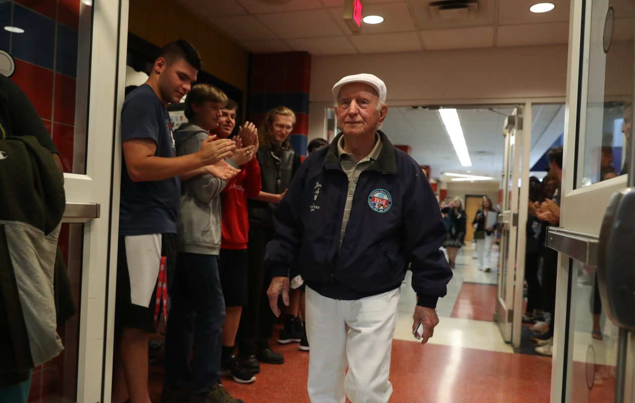 James Vaccarella, 93, is cheered by students at Niagara Falls High School on Thursday. The World War IIArmy veteran shared his memories of experiences in the Battle of the Bulge and in helping to liberate a Nazi concentration camp.   (John Hickey/Buffalo News)