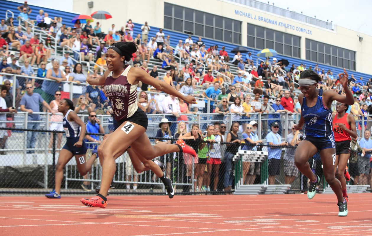 Jayla Moss from Cheektowaga high school wins Section 1 of the Girls 100 Meter Dash Division 2 at the New York State Outdoor Track & Field Championships at Cicero-North Syracuse High School on Saturday June 9, 2018. (Harry Scull Jr./ Buffalo News)