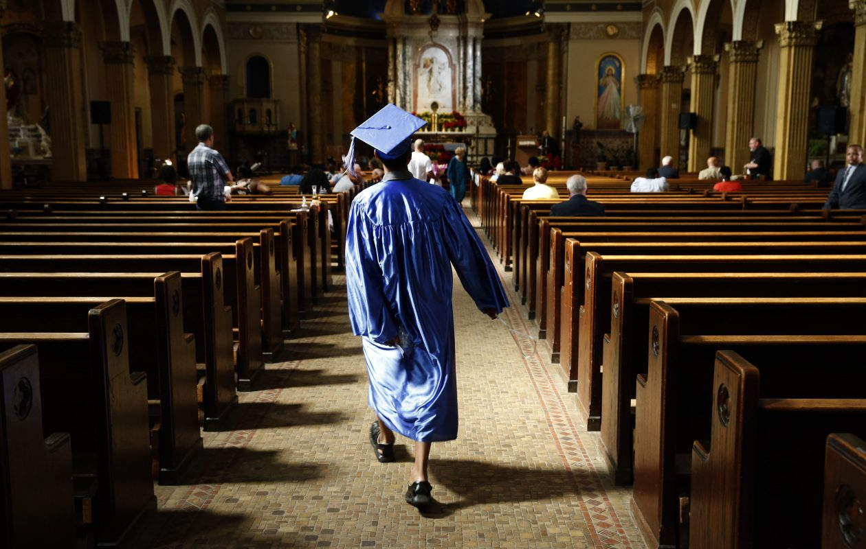 With a jump in his step, eighth grader Joshua Bowman hurries down the aisle of St. Luke's Church prior to commencement graduation Mass for Our Lady of Hope Home School (OLH) last Tuesday.  (Robert Kirkham/Buffalo News)