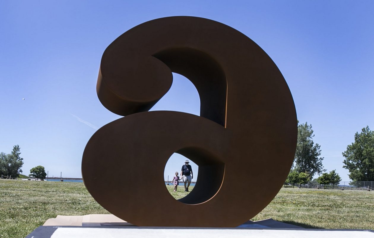 Workers install Robert Indiana's 10 eight-foot tall sculptures of numbers 'NUMBERS ONE through ZERO' at Wilkeson Pointe. Robert Lay and his granddaughter Annalise Lay walk along the riverside and enjoy the sculptures. (Shuran Huang/Buffalo News)