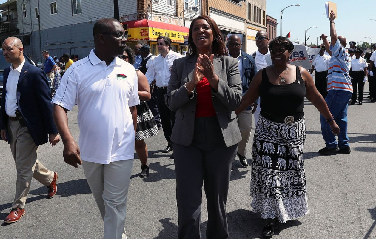 Buffalo Mayor Byron Brown, New York City Public Advocate Tish James and Assemblywoman Crystal Peoples-Stokes greeted people as they walked the Juneteenth Parade on Saturday. (James P. McCoy/Buffalo News)