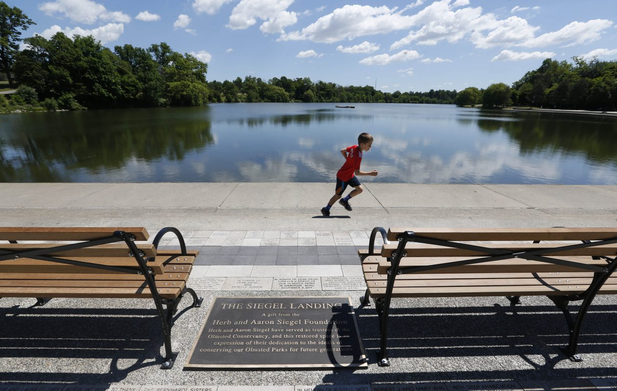 The Olmsted Parks Conservancy just dedicated 'Siegel Landing' an improved landing with new benches and pavers along Hoyt Lake in Delaware Park, Friday, June 15, 2018. (Sharon Cantillon/Buffalo News)
