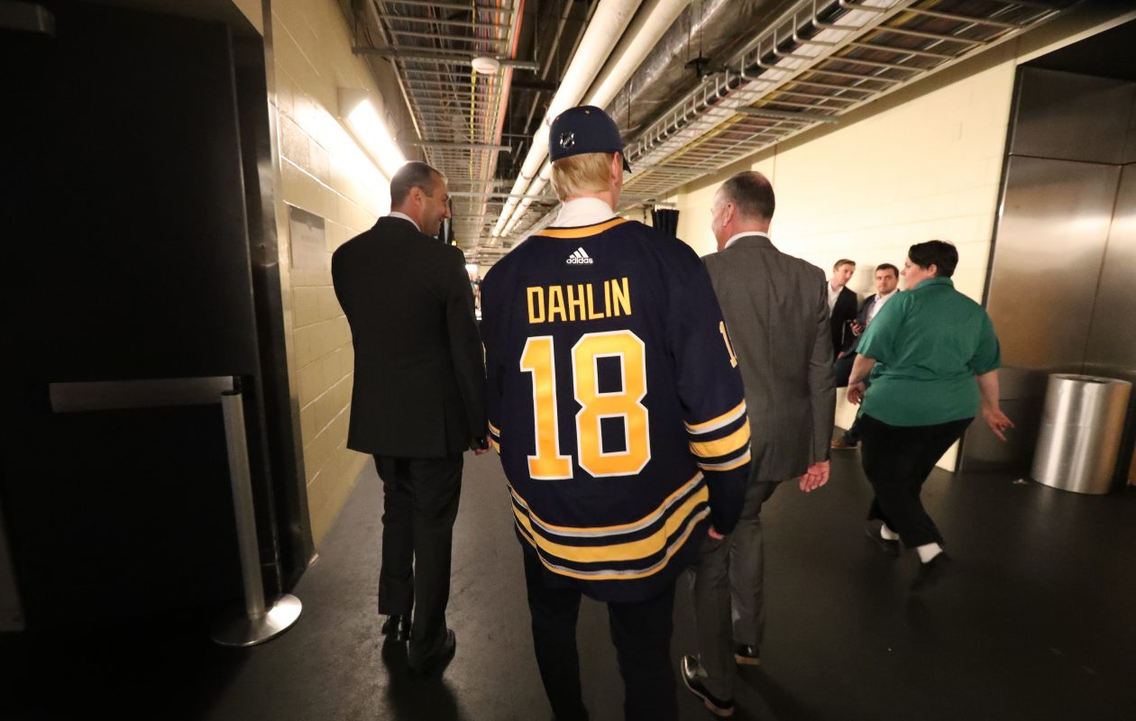 Rasmus Dahlin walks through the hallway at the American Airlines Center after being drafted (James P. McCoy/Buffalo News)