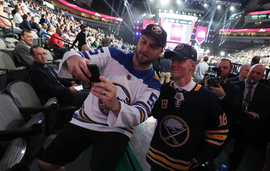 Rasmus Dahlin takes a photo with a fan after being drafted by the Sabres on June 22. (James P. McCoy/Buffalo News)