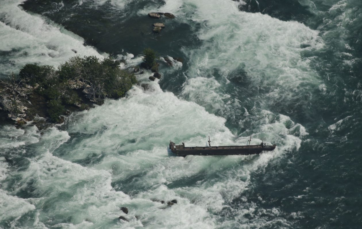 The scow, site of one of the most dramatic rescues in Niagara Falls history, still rests on rocks in the rapids above the Horseshoe Falls in Niagara Falls, Ont. (Derek Gee/Buffalo News)