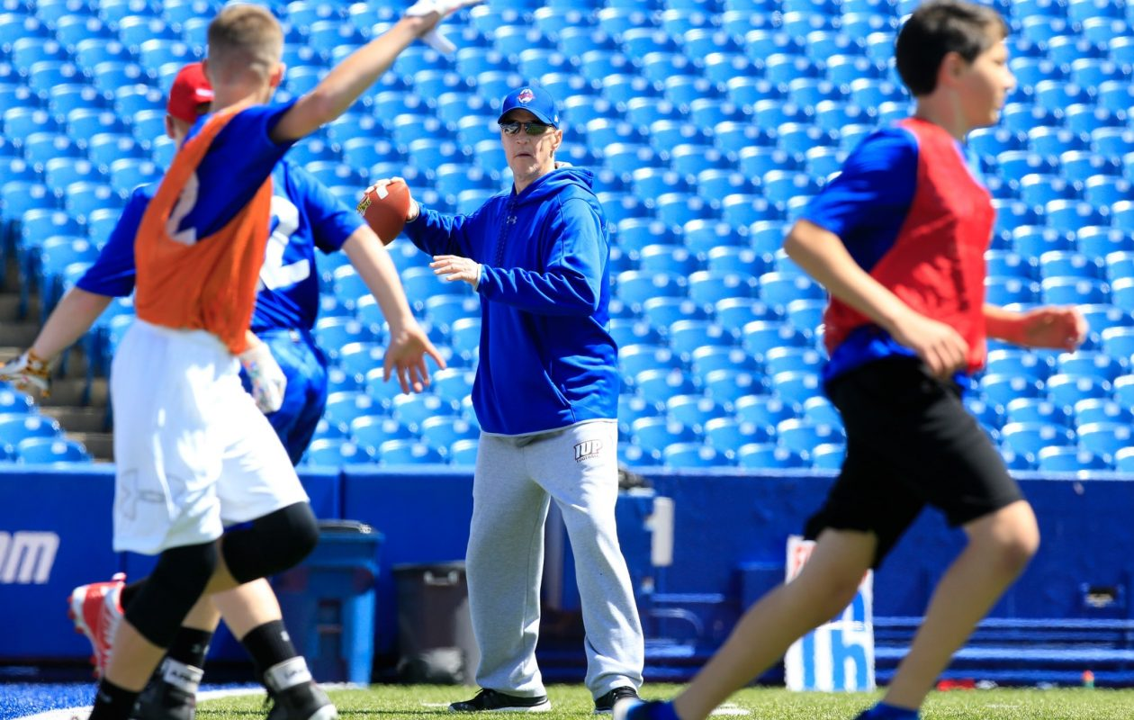 Jim Kelly plays 7-on-7 during the 31st Annual Jim Kelly Football Camp at New Era Field on Monday. (Harry Scull Jr./Buffalo News)