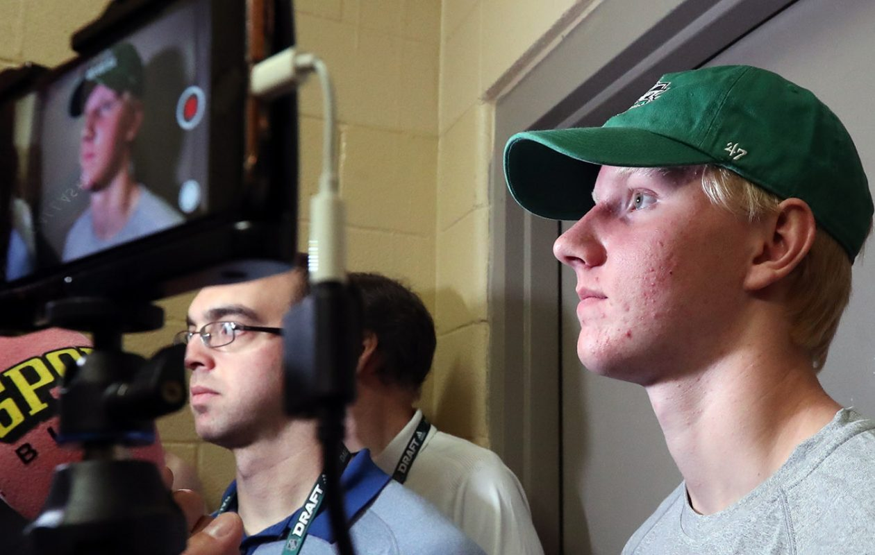 Rasmus Dahlin is interviewed by Swedish TV and radio days before the NHL Draft in Texas. (James P. McCoy/Buffalo News)