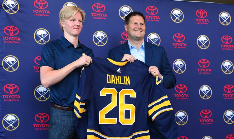 Rasmus Dahlin stands next to Jason Botterill following last June's NHL draft. (John Hickey/News file photo)
