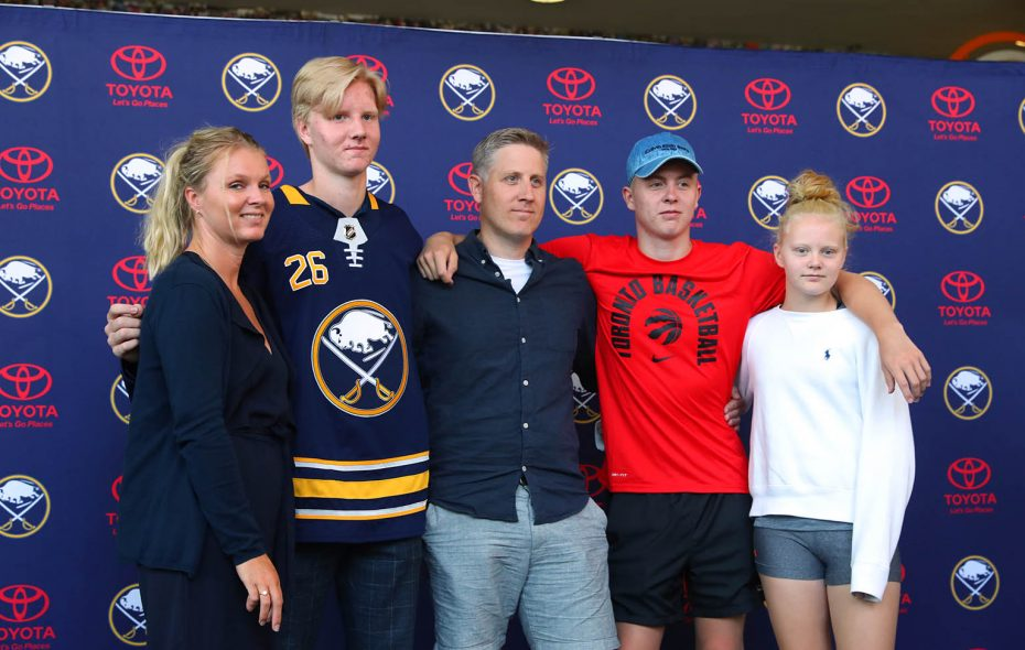 Rasmus Dahlin, wearing his new Buffalo Sabres jersey at his introductory press conference, with his family. From left: His mother, Asa; Rasmus; father, Martin; brother Felix; and sister, Ella. (John Hickey/Buffalo News)