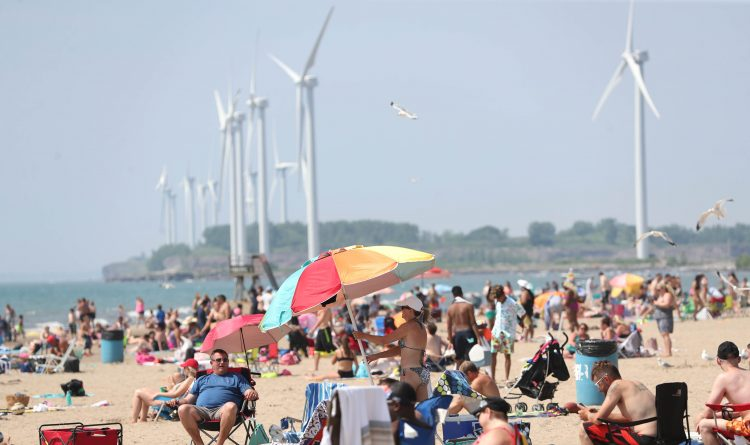 Woodlawn Beach State Park is crowded on a hot day in July 2014. (News file photo)