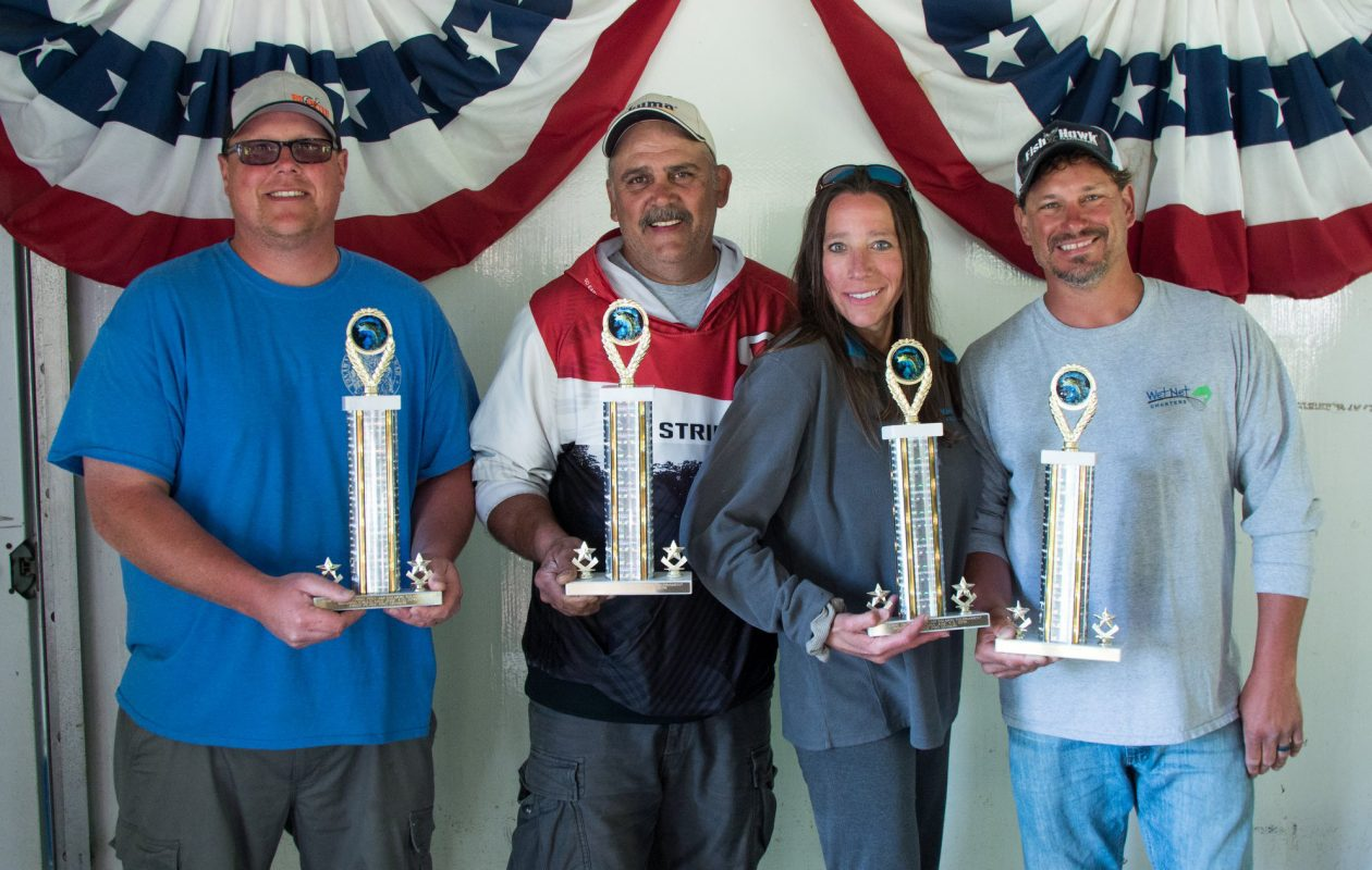 The winning Wet Net team with trophies - Mike Barry of Tonawanda, Jim Dolly, Jr. of Gasport, Christin Yablonsky of Youngstown and Capt. Matt Yablonsky.