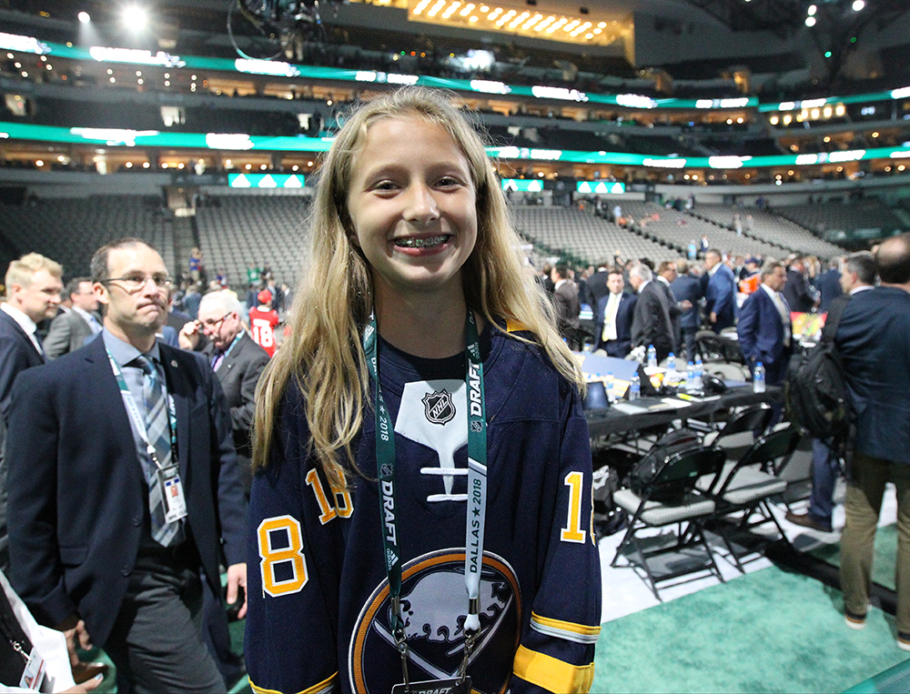 Rosie Bandura, age 11, is the Buffalo Sabres' runner for the draft at The American Airlines Center in Dallas.  (James P. McCoy/Buffalo News)