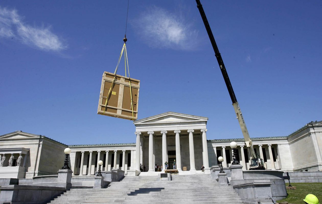 Workers use a crane to lift large crates into the back entrance of the Albright-Knox in 2009. (Derek Gee/News file photo)