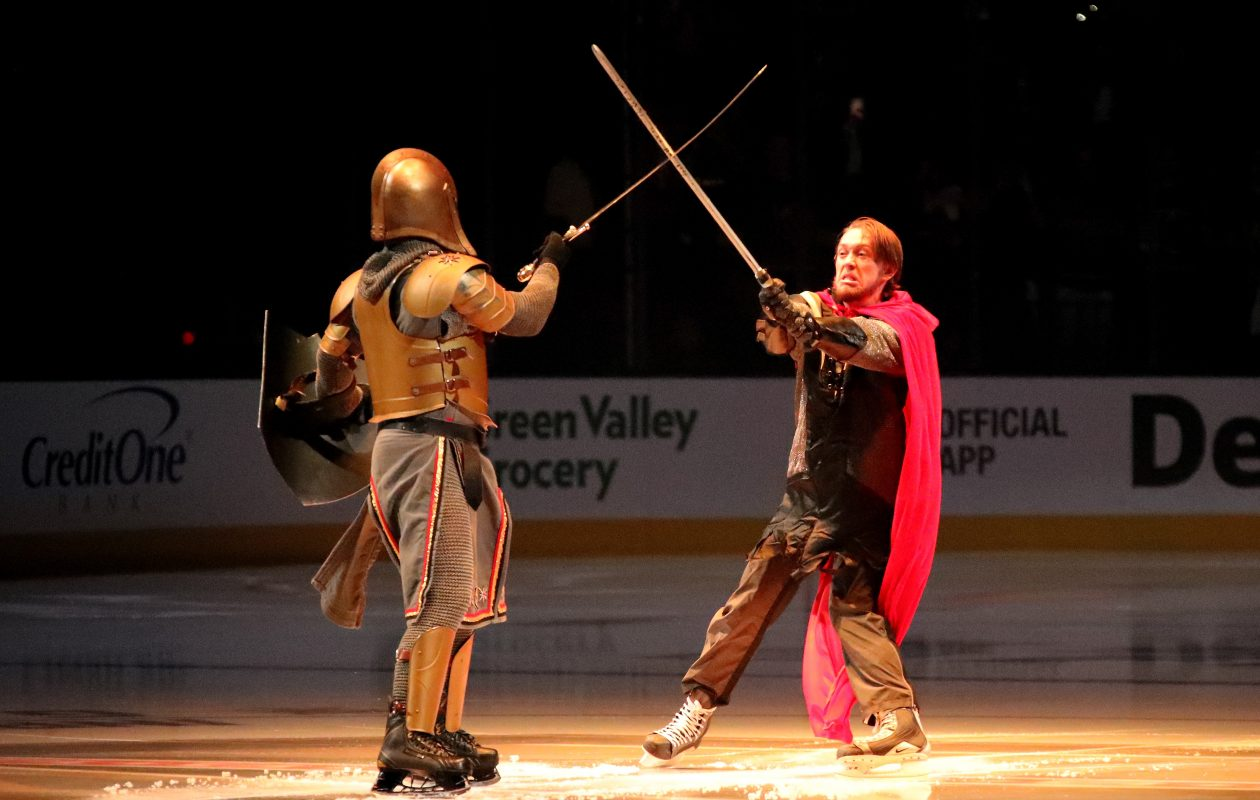 The Golden Knight, a mascot for the Las Vegas Golden Knights hockey team, performs with a Washington Capitals swordsman before Game One of the Stanley Cup finals on May 28. (Bruce Bennett/Getty Images)
