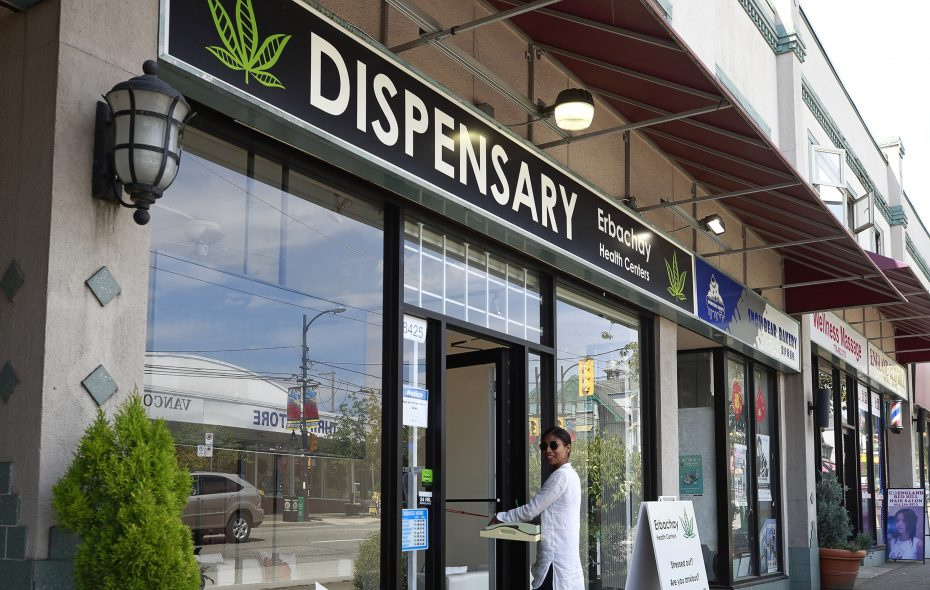 A woman walks into the Erbachay Health Centre Dispensary on Granville Street on June 20, 2018, in Vancouver, B.C. Canadian Prime Minister Justin Trudeau has announced recreational pot will be legal as of Oct. 17 in Canada.  (Getty Images)