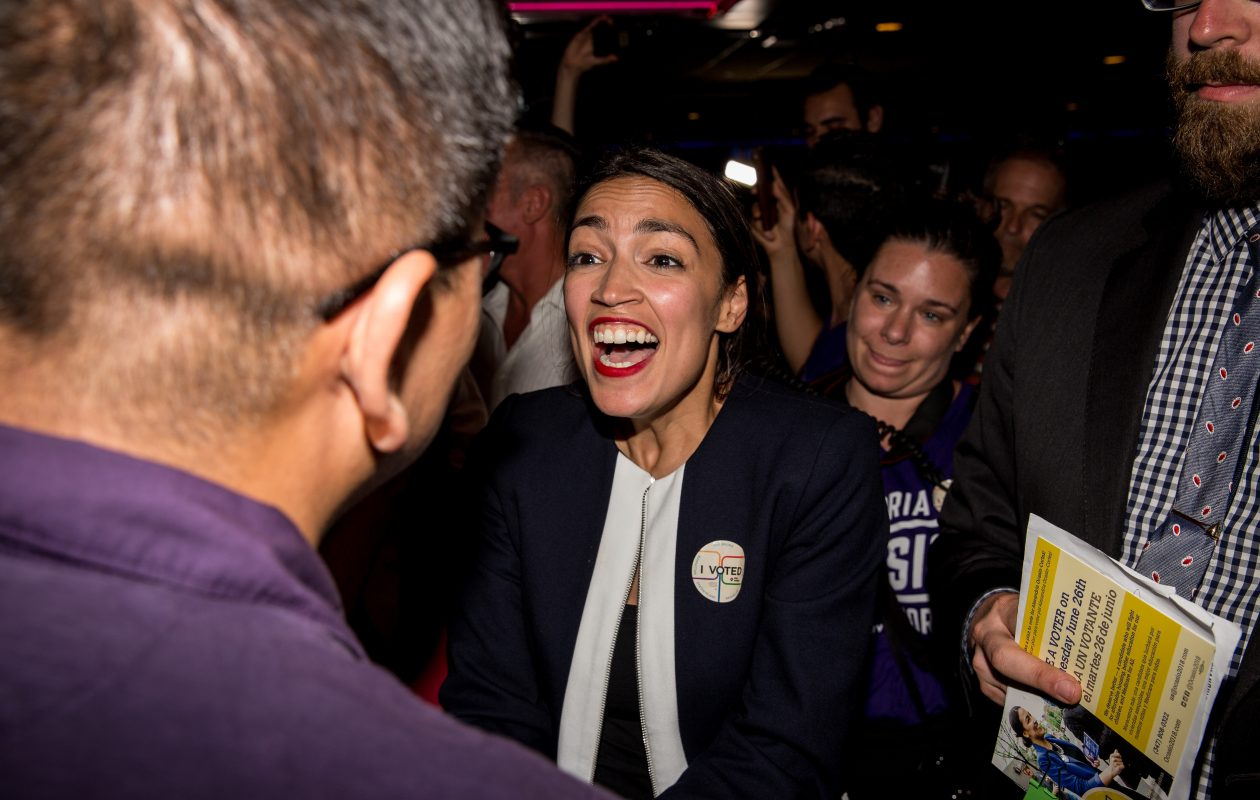 Progressive challenger Alexandria Ocasio-Cortez celebrates with supporters at a victory party in the Bronx after upsetting incumbent Democratic Representative Joseph Crowley on June 26, 2018 in New York City. (Photo by Scott Heins/Getty Images)