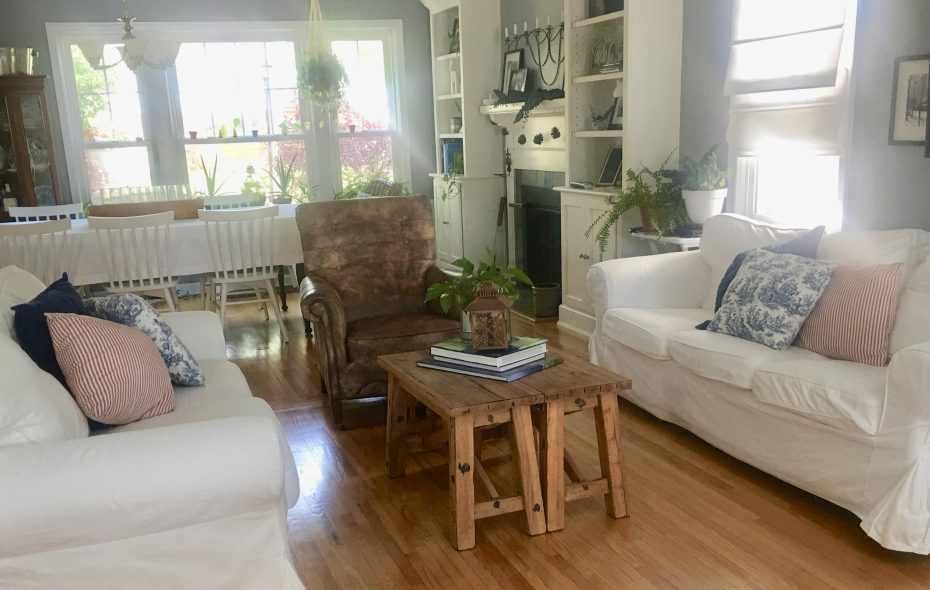 The sitting room features white slip-covered sofas from IKEA that are washable. (Photo courtesy Amie Maranto)