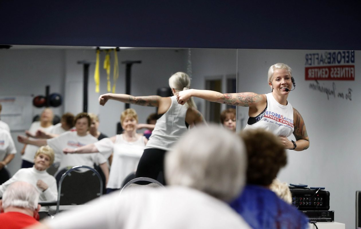Group fitness instructor Holly Kerr leads a SilverSneakers class at Before & After Fitness in North Tonawanda. Kerr leads several classes at the fitness center each week, some designed for seniors, others for all ages. (Mark Mulville/Buffalo News)