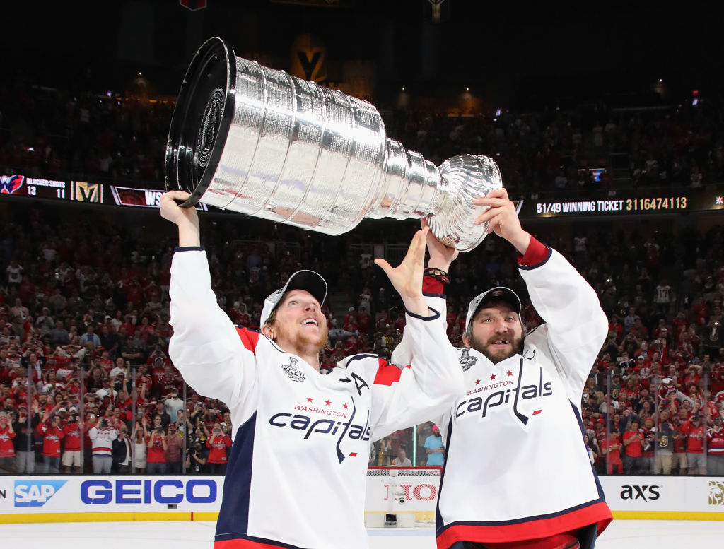 Nicklas Backstrom, left, and Alex Ovechkin hoist the Stanley Cup after the Capitals' clinching win Thursday in Las Vegas.(Getty Images)
