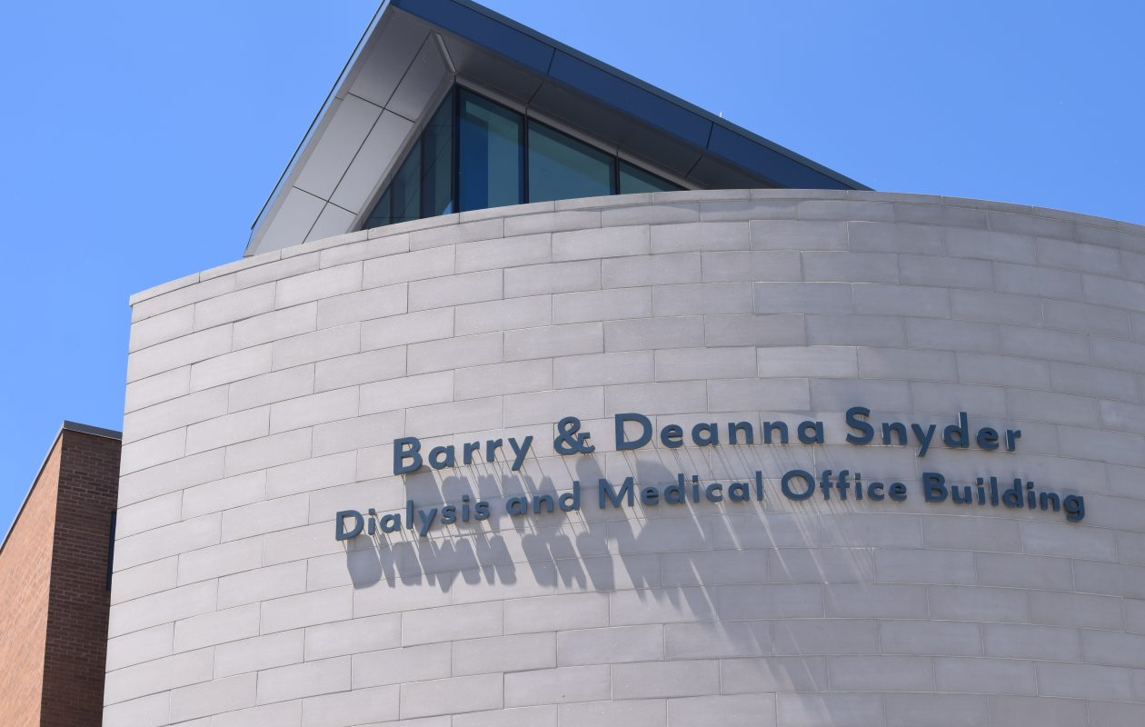 Erie County Medical Center administrators on Tuesday unveiled a new sign officially dedicating the Barry & Deanna Snyder Dialysis and Medical Office Building. (Sam Ogozalek/Buffalo News)