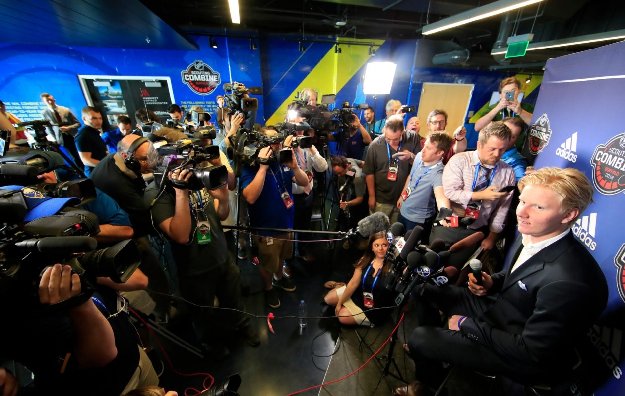 Rasmus Dahlin, right, met with a large media scrum earlier this month at Buffalo's HarborCenter. (Harry Scull Jr./Buffalo News)
