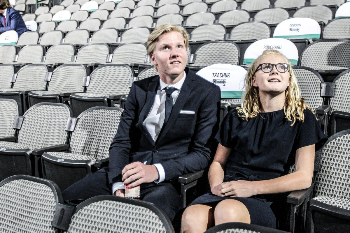 Rasmus Dahlin atakes his seat with his younger sister at the NHL Entry Draft (James P. McCoy/ Buffalo News)