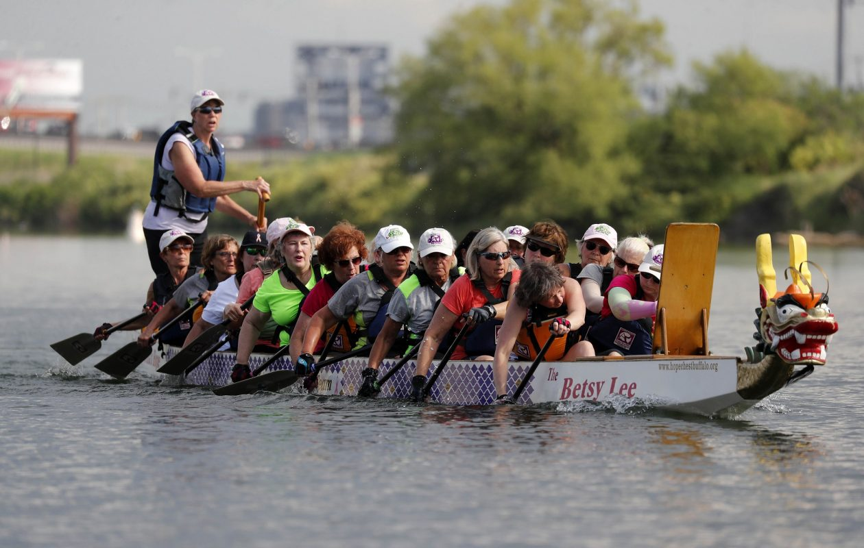 """Cancer survivors, including Cynthia Gromada-Dominske, in the fluorescent green shirt, practice late last month for this weekend's Hope Chest Dragon Boat Festival at RiverWorks. """"I feel a lot stronger after preparing for the races,"""" Gromada-Dominske said. (Mark Mulville/Buffalo News)"""