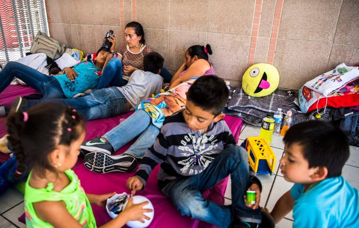 Members of the Romero and Arcos Avila families wait at the Nogales Port of Entry on the Mexican side of the U.S. border Thursday, hoping to request asylum in the United States. (Stuart Palley for The Washington Post)