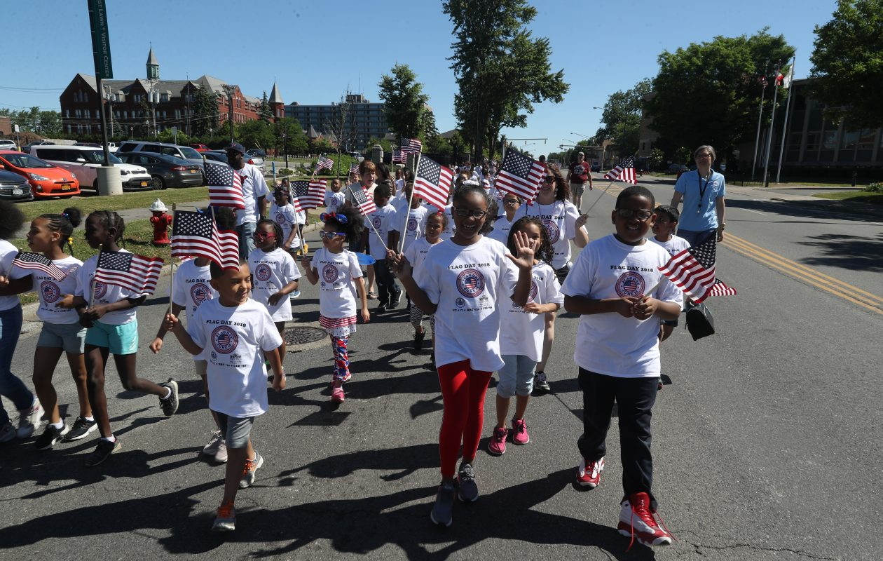 About 600 students from Buffalo Public Schools 17, 31 and 54 marched in the annual Flag Day parade and ceremony at Forest Lawn Cemetery on Thursday, June 14, 2018. (John Hickey/Buffalo News)