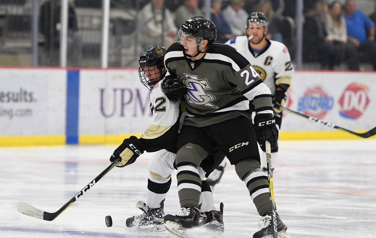 Jake Crespi of the Tri-City Storm hits on Matej Pekar (No. 12) of the Muskegon Lumberjacks during the game on Sept. 30, 2018, on Day 3 of the USHL Fall Classic at UPMC Lemieux Sports Complex in Cranberry Township, Pennsylvania. (Photo by Justin Berl/Getty Images)