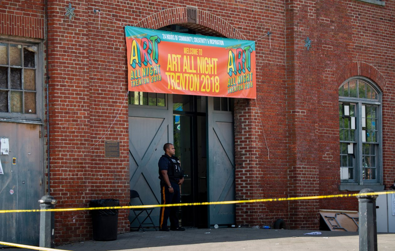 Police officers inspect the crime scene at the Roebling Market on June 17, 2018, the morning after a shooting at an all-night art festival injured 20 people and left one suspect dead in Trenton, N.J. (DOMINICK REUTER/AFP/Getty Images)