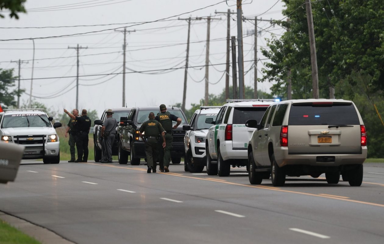 Police armed with long guns looking for the robber who on Grand Island. (James P. McCoy/Buffalo News)